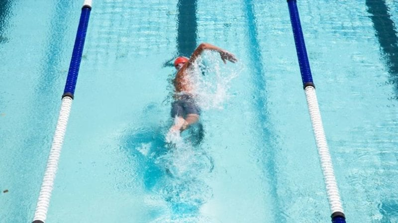 Male lap swimming in pool